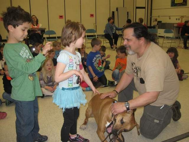 Army Ranger Brian Gahns introduces his service dog, Rusty, to kindergarteners at Country Elementary School in Hamburg Township. / SUBMITTED PHOTO